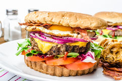 Beef burger, red onion and fried egg Stock Photos