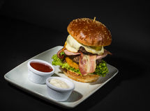 Beef Burger. Served with chips and mayo Stock Photos