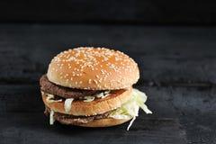 Beef Burger with sesame bun close-up royalty free stock photos
