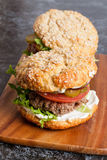 Beef burger with vegetables on a desk close-up Royalty Free Stock Photos