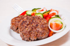 Beef burger with vegetables salad Stock Images