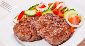 Beef burger with vegetables salad Royalty Free Stock Images