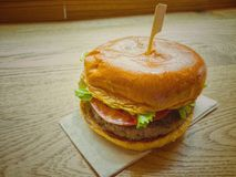 Beef burger on wood table. Beef burger on wood Royalty Free Stock Photo
