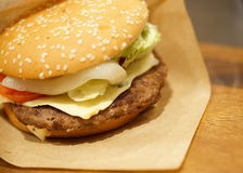 Beef burger on wood table, close-up image, focus on the beef Royalty Free Stock Photos