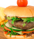 Beef burger on the wooden plate with fried potato Royalty Free Stock Image
