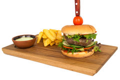 Beef burger on the wooden plate with fried potato Stock Photo