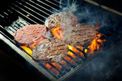 Beef burgers being cooked Royalty Free Stock Images
