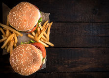 Beef burgers and french fries Royalty Free Stock Images