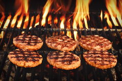 Beef Burgers On The Hot Flaming BBQ Charcoal Grill Stock Photos