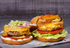 Beef burgers with red, yellow peppers, napa cabbage and cheddar. Stock Images