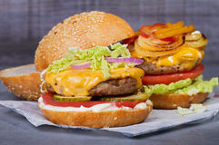 Beef burgers with red, yellow peppers, napa cabbage and cheddar. Royalty Free Stock Photo