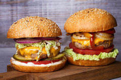 Beef burgers with red, yellow peppers, napa cabbage and cheddar. Stock Photography