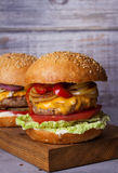 Beef burgers with red, yellow peppers, napa cabbage and cheddar. Stock Photo