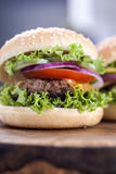 Beef burgers on a wooden board with aromatic spices Royalty Free Stock Photos