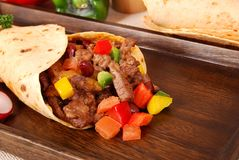 Beef burrito wrap sandwich close up Stock Images