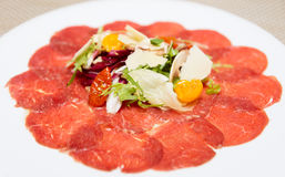 Beef carpaccio. Carpaccio of beef, mushrooms, ruccola and cheese royalty free stock images