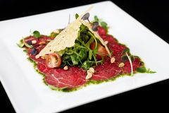 Beef carpaccio. On black background stock photography
