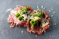 Beef carpaccio appetizer with baby asparagus Stock Image