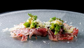 Beef carpaccio appetizer with baby asparagus Stock Photo