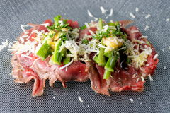 Beef carpaccio appetizer with baby asparagus Royalty Free Stock Images