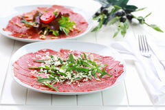 Beef Carpaccio with arugula and parmesan Royalty Free Stock Photography