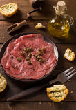 Beef carpaccio with capers Royalty Free Stock Photo