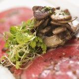 Beef carpaccio with mushrooms. Stock Photos
