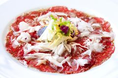 Beef carpaccio with parmesan cheese. Royalty Free Stock Photography