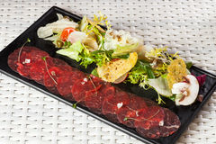 Beef carpaccio with parmesan cheese, capers and Stock Photo