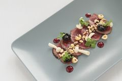 Beef carpaccio plated starter Royalty Free Stock Photos