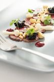 Beef carpaccio plated starter Stock Photo