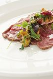 Beef carpaccio plated starter Royalty Free Stock Photo