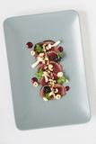 Beef carpaccio plated starter Royalty Free Stock Photography