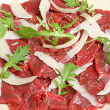 Beef Carpaccio with Rocket and Parmesan Cheese Royalty Free Stock Photo