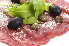 Beef carpaccio with rucola and parmesan Stock Photos