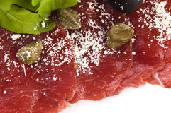 Beef carpaccio with rucola and parmesan Stock Photo