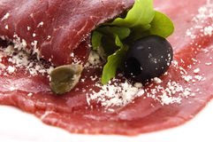 Beef carpaccio with rucola and parmesan Royalty Free Stock Image
