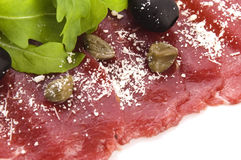 Beef carpaccio with rucola and parmesan Royalty Free Stock Images