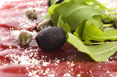 Beef carpaccio with rucola and parmesan Stock Image