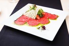 Beef carpaccio with salad Stock Image