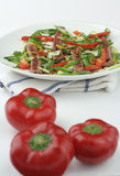 Beef carpaccio salad; capsicum in foreground Royalty Free Stock Image