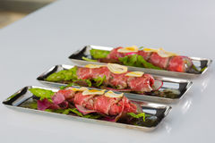 Beef carpaccio with salad leaves and vegetabales. tasty appetize Stock Images