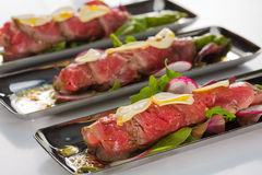 Beef carpaccio with salad leaves and vegetabales. tasty appetize Stock Image