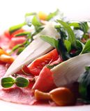 Beef carpaccio served with ruccola Royalty Free Stock Images