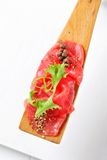 Beef Carpaccio on spatula Royalty Free Stock Photos