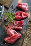 Thinly sliced beef pieces. beef carpaccio stock photography