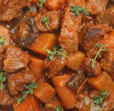 Beef Casserole. D with carrots, swede, tomato, mushroom and shallots. Garnished with sprigs of thyme Stock Photo