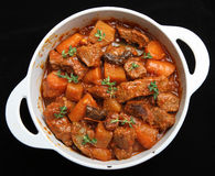 Beef Casserole Stew & Vegetables. Casseroled beef and vegetables in an enamelled cast-iron pot Stock Image