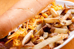 Beef and cheddar sandwich with fries Stock Photo
