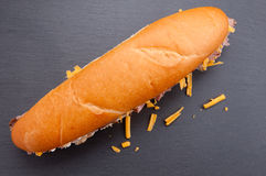 Beef and cheddar sandwich with fries Royalty Free Stock Photos